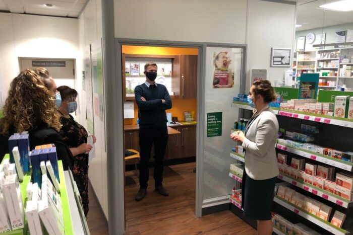 Jeremy Hunt MP in the consultation room of a LloydsPharmacy, socially distanced from the pharmacy team
